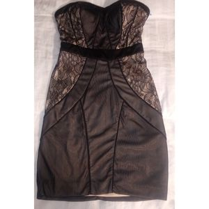 Black and nude strapless BeBe mini dress